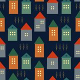 Cute houses and autumn trees seamless pattern on dark blue background. Stock Photography