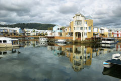 Cute houses in Knysna channel Royalty Free Stock Photos
