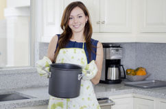 Cute housewife cooking dinner Royalty Free Stock Images