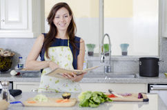 Cute housewife making dinner Stock Photos