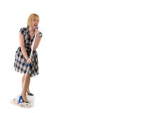 Cute housewife sings to broom handle Royalty Free Stock Photography