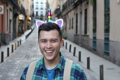 Cute human unicorn smiling outdoors stock photos