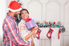 Cute husband and wife are celebrating Christmas Royalty Free Stock Photo