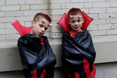 Cute identical boy twins disguised as devils stock photo