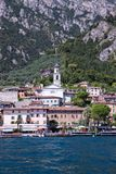 Cute idyllic Italian village and lake captured from the water. Limone at lago di Garda. Idyllic coastline scenery in Italy, captured from the water. Blue water stock images