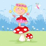 Lovely little fairy dancing on the red mushroom and cute butterfly Royalty Free Stock Photo