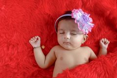 Cute Indian baby girl sleeping on bed. royalty free stock photos