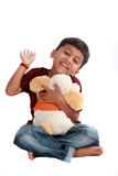 Cute Indian Boy. A cute Indian boy happy with his stuffed toy, on white studio background Stock Photos