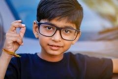 Cute Indian child wear eyeglass.  royalty free stock photo