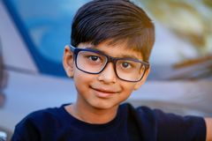 Cute Indian child wear eyeglass.  royalty free stock photography