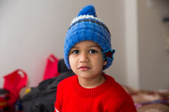 Free Cute Indian Kid Striking A Pose In Winter Wear With A Cute Smile Stock Photo - 66393760