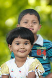 Cute indian kids(brother and sister) having good time in a park Royalty Free Stock Photo