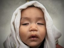 Cute infant Asian boy sleeping with diaper on his bag stock photo