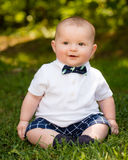Cute infant baby boy wearing a bow tie. Spring portrait of cute infant baby boy wearing a bow tie Royalty Free Stock Photography