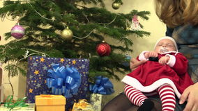 Cute infant baby in christmas dress fall asleep on mother hands stock video footage