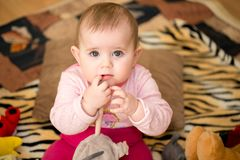 Cute infant baby girl. The first year of the new life Stock Image
