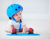 Cute Infant Baby Girl In Protective Helmet Outfit Ready To Ride Skateboard, Extreme Sport Concept Royalty Free Stock Image