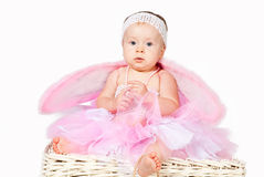Cute infant baby girl thinking isolated Royalty Free Stock Photo