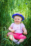 Cute infant baby in grass Royalty Free Stock Image
