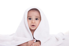 Cute infant baby under the white towel Royalty Free Stock Images