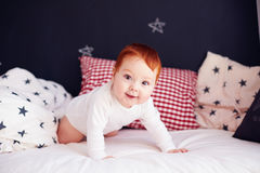 Cute infant baby waking up in his bed Royalty Free Stock Photos