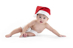 Cute infant baby wearing Santa hat Stock Photo