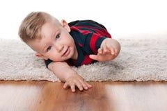 Cute infant boy on the carpet Stock Photo