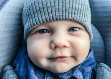 Cute infant boy closeup. Cute infant boy in winter clothes closeup Royalty Free Stock Images