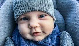 Cute infant boy closeup. Cute infant boy in winter clothes closeup Royalty Free Stock Photography
