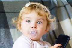 Cute infant with cellular Royalty Free Stock Images
