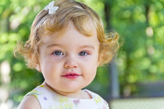 Cute infant with curly blond hair Stock Photos