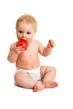Cute infant girl with apple Royalty Free Stock Photos