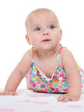 Cute infant girl imagines. A cute infant girl imagines on the white towel royalty free stock image