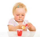 Cute infant girl learining to eat Stock Photo
