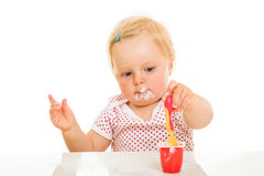 Cute infant girl learining to eat Royalty Free Stock Photos