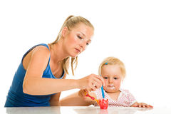 Cute infant girl learining to eat Stock Images