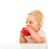 Cute infant girl learining to eat Royalty Free Stock Images