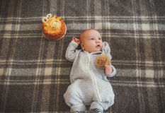 Cute infant lying on his back. Cute infant celebrating his two month birthday Stock Photo