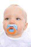 Cute infant with pacifier. In mouth.  Focus on eyes Royalty Free Stock Photography