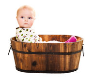 Cute infant in wooden bucket Stock Photo
