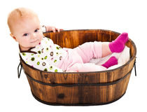 Cute infant in wooden bucket Royalty Free Stock Photography