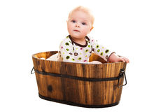 Cute infant in wooden bucket Royalty Free Stock Image