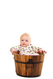 Cute infant in wooden bucket Royalty Free Stock Photo