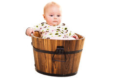 Cute infant in wooden bucket Royalty Free Stock Photos