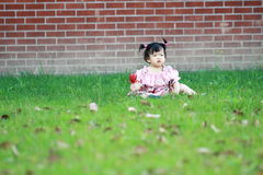 Cute innocent baby girl play on the lawn Stock Photography