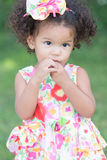 Cute and innocent latin girl with a colorful dress Royalty Free Stock Photos