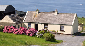 Cute irish cottage by the ocean for rental Royalty Free Stock Image