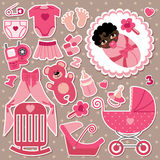 Cute items for mulatto  baby girl. A set of cute cartoon elements for mulatto newborn baby girl .Baby cartoon icons,scrapbooking elements in polka dot background Stock Photo