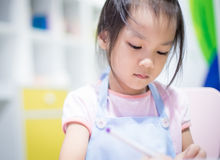 Cute Japanese girl is learning art Royalty Free Stock Photos