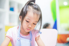 Cute Japanese girl is learning art Stock Image